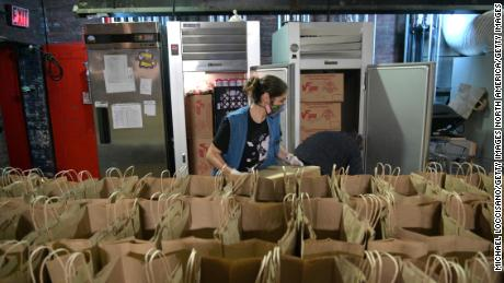 Kaylyn Kilkuskie, an Abrons Arts Center artist, prepares groceries for families in need throughout the Lower East Side on October 06, 2020 in New York City. Food donation and delivery has surged since the start of the pandemic.