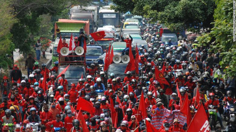 Indonesians police fire water cannons at protesters rallying against jobs law