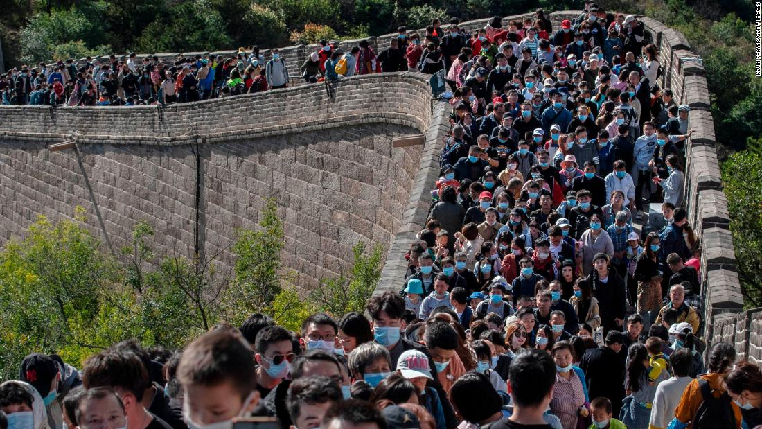 Tourists crowd together in Beijing as they move slowly on a section of the Great Wall of China on October 4. The scene would have been unthinkable just months ago.
