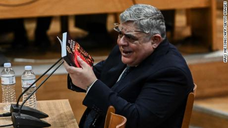 Former MP and leader of Golden Dawn party, Nikolaos Michaloliakos, testifies before the criminal appeal court in Athens, in November 2019.
