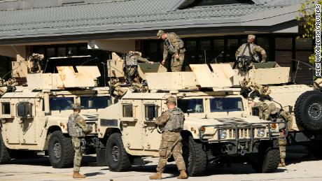 National Guard members are seen outside the Wisconsin State Fair exposition center in West Allis on Wednesday, where a field hospital to treat Covid-19 patients has been set up.