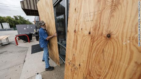 Michael Vice boards up Thursday to prepare for the arrival of Hurricane Delta in Houma, Louisiana.