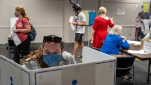 States grapple with mask rules at polls to avoid dangers of both superspreaders and standoffs