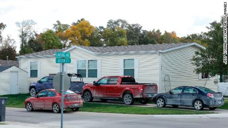 Vehicles are seen outside of a Hartland Township mobile home park the FBI searched late Wednesday night and into the morning in connection of a plot to kidnap Michigan Gov. Gretchen Whitmer.