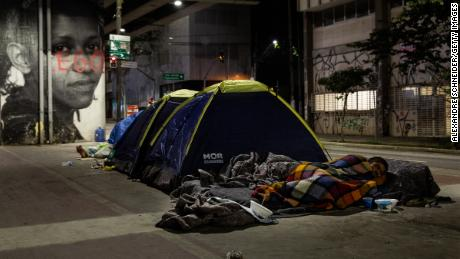 Homeless people sleep in tents in the sidewalk in downtown on August 28, 2020 in Sao Paulo, Brazil.  Due to the pandemic, unemployment is rising and the number of people living on the streets has increased considerably.