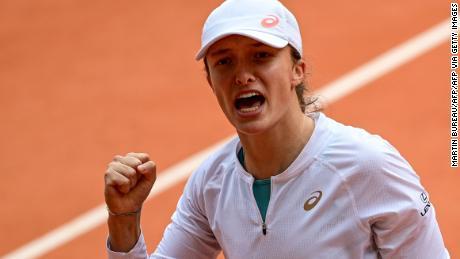 Swiatek celebrates in her French Open semifinal against Nadia Podoroska.