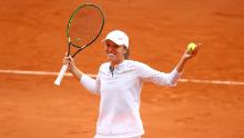 Swiatek reacts after winning match point in her French Open semifinal.