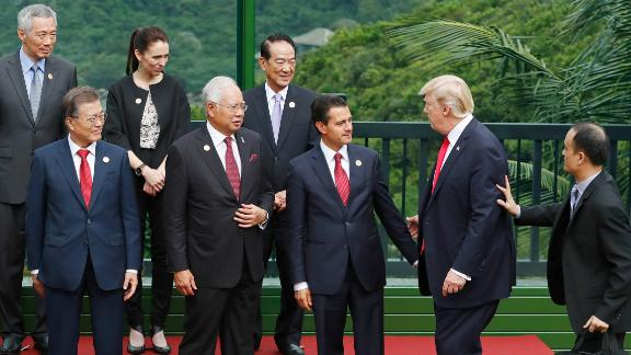 """United States President Donald Trump joins South Korea's President Moon Jae-in, Malaysia's Prime Minister Najib Razak, Mexico's President Enrique Pena Nieto, Singapore's Prime Minister Lee Hsien Loong, New Zealand's Prime Minister Jacinda Ardern and Taiwan's representative James Soong to take part in a """"family photo"""" during the Asia-Pacific Economic Cooperation (APEC) leaders' summit in the central Vietnamese city of Danang on November 11, 2017."""
