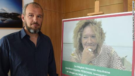 Sébastien Chadaud-Pétronin beside a photograph of his mother, Sophie Pétronin, in Bordeaux on August 29, 2018.