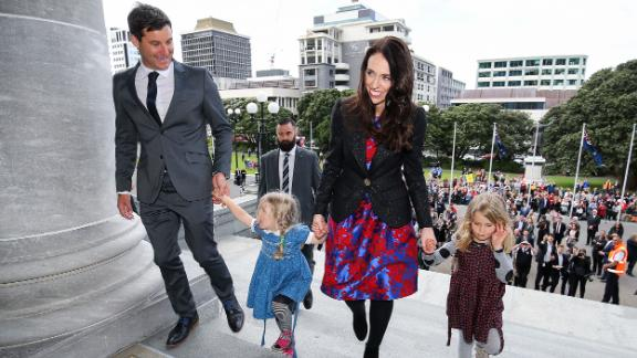 Prime Minister Jacinda Ardern, her partner Clarke Gayford, and Gayford's nieces Rosie and Nina Cowan arrive at Parliament after a swearing-in ceremony at Government House on October 26, 2017.