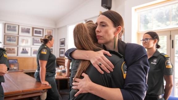 Jacinda Ardern hugs a first responder from the St John's ambulance team that helped those injured in the White Island volcano eruption on December 9, 2019.