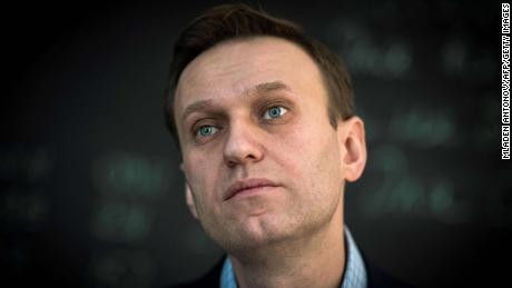 Russian authorities threaten to jail Navalny if he doesn't show up in Moscow by Tuesday morning