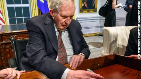 Lyon Gardiner Tyler Jr. signs his name on the inside of a desk drawer with other descendants of past presidents who gathered in Washington in August 2018.