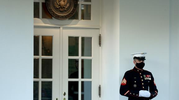 WASHINGTON, DC - OCTOBER 08: A U.S. Marine stands guard outside the West Wing at the White House October 08, 2020 in Washington, DC. According to the White House, President Donald Trump was in the Oval Office Thursday, four days after returning from from Walter Reed National Military Medical Center after testing positive and being treated for COVID-19. (Photo by Chip Somodevilla/Getty Images)