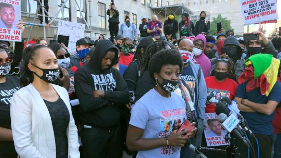 Alvin Cole's sister speaks outside Milwaukee County Courthouse on Wednesday.
