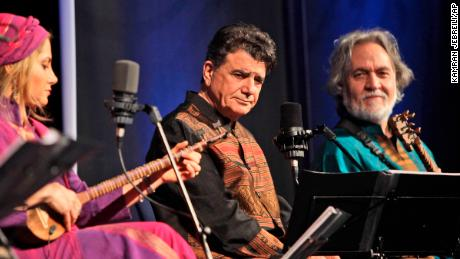 Iran's greatest master of Persian classical music Mohammad Reza Shajarian, middle, performs with Mojgan Shajarian, 2nd left, and Majid Derakhshani composer, 2nd right, during a concert with Shahnaz Ensemble band in Dubai, United Arab Emirates, Thursday, Feb. 17, 2011.