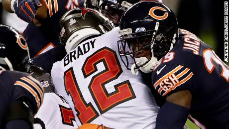 Brady is tackled by Eddie Jackson of the Chicago Bears.