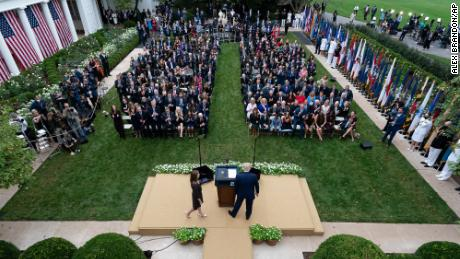 Judge Amy Coney Barrett walks to the microphone after President Donald Trump, right, announced Barrett as his nominee to the Supreme Court, in the Rose Garden at the White House, Saturday, Sept. 26, 2020, in Washington. (AP Photo/Alex Brandon)