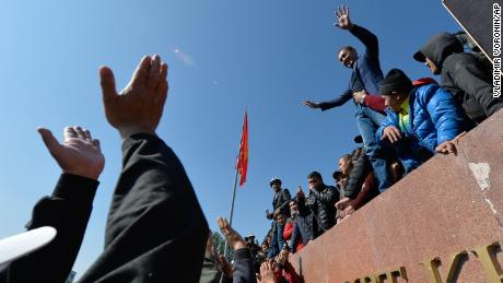 People protest during a rally in Bishkek, Kyrgyzstan, on October 7, 2020.