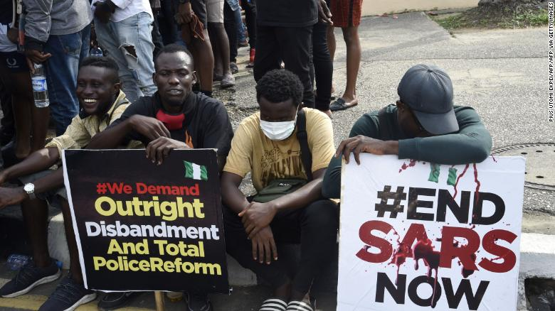 Young men take part in a demonstration calling for the scrapping of the controversial Special Anti-Robbery Squad, or SARS police unit, in Ikeja, on October 8.