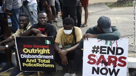 Young people take part in a demonstration calling for the demolition of the controversial Anti-Robbery Task Force, or SARS police unit, in Ikeja on 8 October.