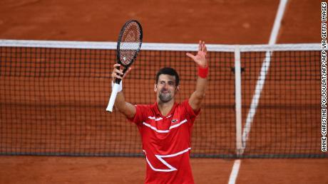 Djokovic celebrates his five-set victory over Tsitsipas.