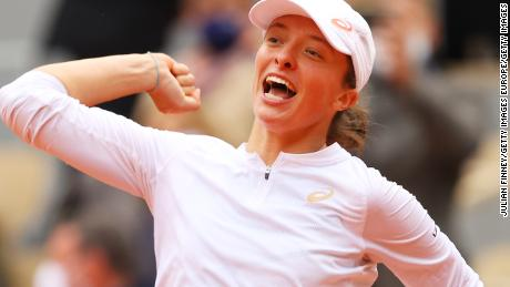 Iga Swiatek of Poland celebrates after winning the women's singles final at the French Open in Paris against Sofia Kenin of the United States.