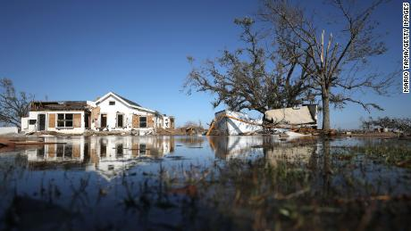 Structures sit in floodwaters Saturday in Creole, Louisiana.