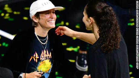 Sue Bird (R) celebrates with Megan Rapinoe after winning the WNBA Championship following Game 3 of the WNBA Finals against the Las Vegas Aces at Feld Entertainment Center in Palmetto, Florida.