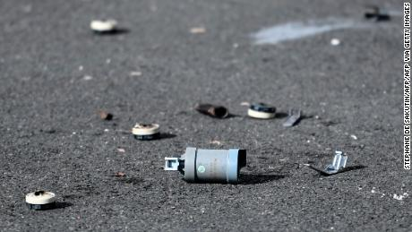A tear gas canister is shown in Champigny-sur-Marne, a suburb of Paris, the morning after a police station was attacked.
