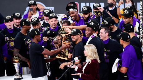 The Lakers celebrate with the trophy after winning the 2020 NBA Finals in Lake Buena Vista, Florida.