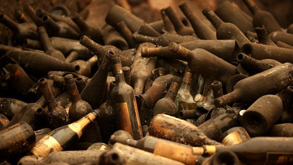 Burned bottles of wine sit in a pile at the Castello di Amorosa winery, which was destroyed by the Glass Fire in Calistoga, California, on October 1. Wildfires have damaged and destroyed dozens of the region's famed wineries, many of them family-owned businesses.