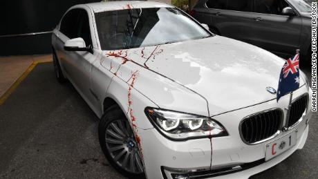 Protesters doused Morrison's car and a building in red liquid, CNN affiliate 7 news reported.