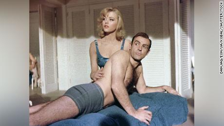 "As well as appearing in the ""Goldfinger"" title sequence, Nolan also played Bond's masseuse, Dink."