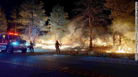 The Colorado Wild Horse Fire leapt over a highway to burn in a training area at the Fort Carson Army base.