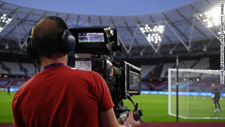 A television cameraman follows the action during the English Premier League football match between West Ham United and Newcastle United.