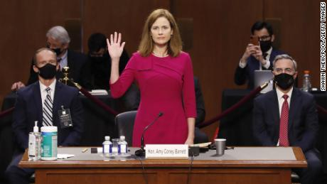 WASHINGTON, DC - OCTOBER 12:  Supreme Court Justice nominee Judge Amy Coney Barrett stands as she is sworn in during the Senate Judiciary Committee confirmation hearing for Supreme Court Justice in the Hart Senate Office Building on October 12, 2020 in Washington, DC. With less than a month until the presidential election, President Donald Trump tapped Amy Coney Barrett to be his third Supreme Court nominee in just four years. If confirmed, Barrett would replace the late Associate Justice Ruth Bader Ginsburg. (Shawn Thew-Pool/Getty Images)