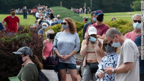 Voters wait in line to cast their ballot at an early voting location in Fairfax, Virginia on September 18, 2020. - Early in-person voting for the 2020 general election kicked off on September 18, 2020 in Virginia (Photo by ANDREW CABALLERO-REYNOLDS / AFP) (Photo by ANDREW CABALLERO-REYNOLDS/AFP via Getty Images)