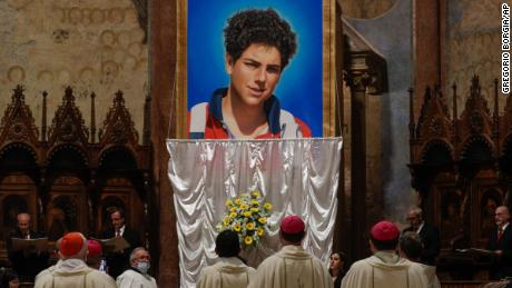 An image of 15-year-old Carlo Acutis, an Italian boy who died in 2006 of leukemia, is unveiled during his beatification ceremony celebrated by Cardinal Agostino Vallini in the St. Francis Basilica, in Assisi, Italy, Saturday, Oct. 10, 2020. (AP Photo/Gregorio Borgia)