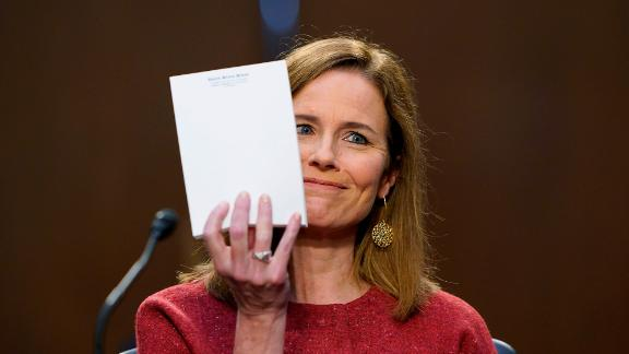 Barrett holds up a blank piece of paper after US Sen. John Cornyn, a Republican from Texas, asked her what notes she was using during her testimony.