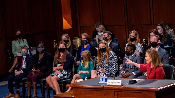 Barrett introduces her family during her hearing on October 13. She and her husband, Jesse, have seven children.