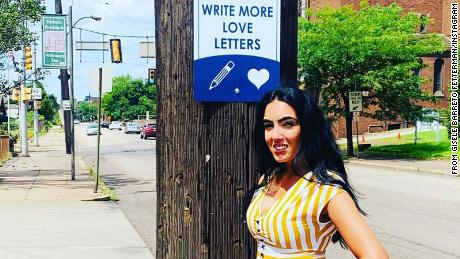 One of Braddock's signs encouraged folks to write more love letters, which Fetterman enjoys doing.