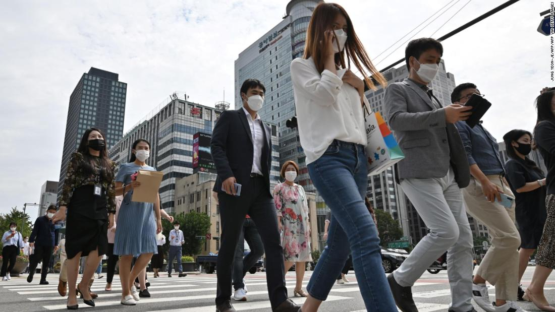 South Korea mandates mask-wearing to fight Covid-19 as face coverings remain controversial in the US