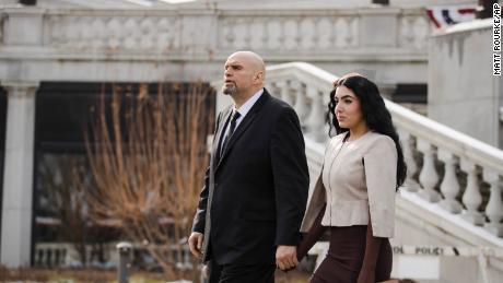 John and Gisele Fetterman walk to Pennsylvania Gov. Tom Wolf's inauguration last year.