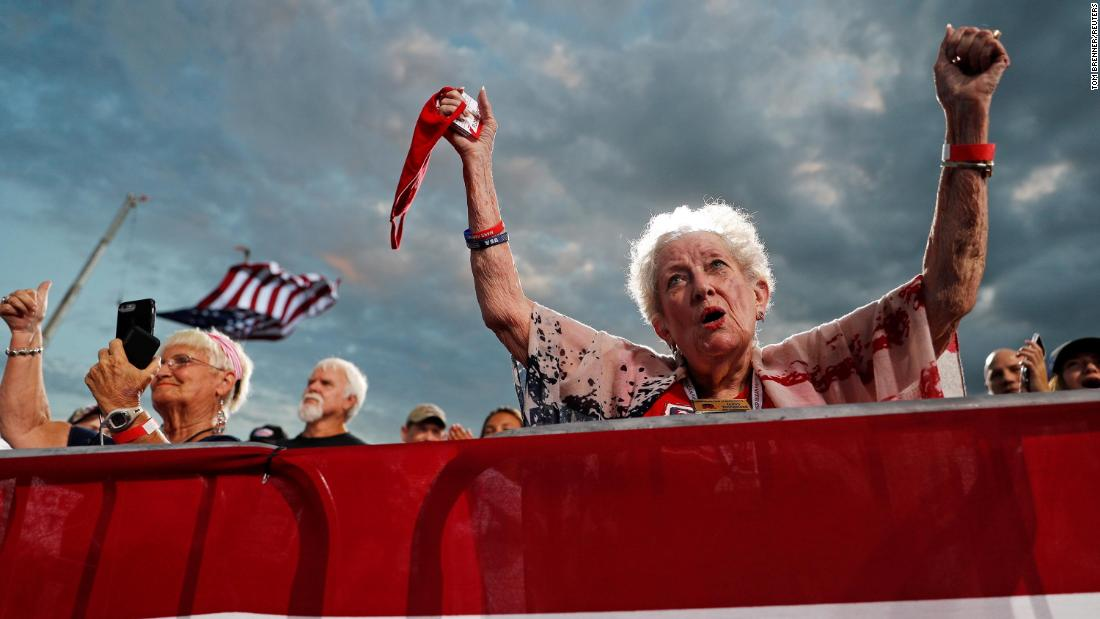 People cheer for Trump at a campaign rally at Cecil Airport in Jacksonville, Florida, on September 24.