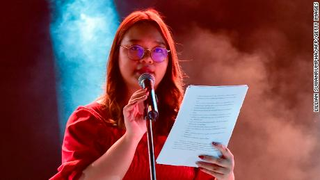 Panusaya Sithijirawattanakul reads a list of demands including the abolition of the kingdom's draconian royal defamation law during a pro-democracy rally at Thammasat University on August 10, 2020