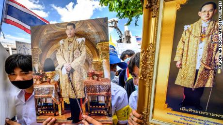 Demonstrators hold portraits of Thailand's King Maha Vajiralongkorn and his late father king Bhumibol Adulyadej during a pro-government and pro-monarchy rally in Bangkok on July 30, 2020.
