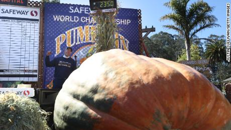 Travis Gienger pumps his fist as he stands next to his pumpkin during the competition in California.