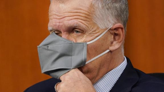 """US Sen. Thom Tillis, a Republican from North Carolina who recently tested positive for Covid-19, puts his hand under his face mask while Barrett testifies on October 13. Tillis announced during the hearing that he's participating in two studies. He said he enrolled in the studies during his time in quarantine. """"Because this is being aired, I hope anyone who has recovered from Covid will do their part to try heal this country from the health challenges that Covid has presented us,"""" Tillis said. """"I intend to do my part."""""""