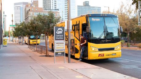 Shuttles take students to and from the different campuses. Social distancing is followed while on the bus.